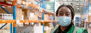 Warehouse worker wearing a mask